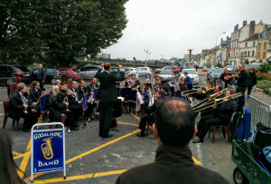 MD James Haigh brings the band off from playing All I Ask of You