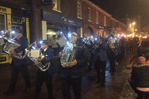 Godalming Band leading the town's torchlight procession
