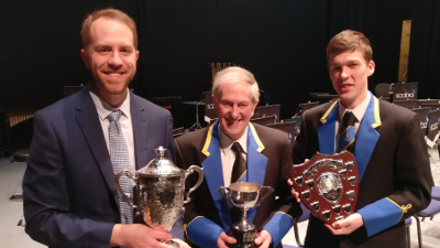 MD James Haigh, Ray Pont and principal cornet Matthew Tate picking up trophies in the spring